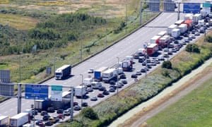 Lorries and cars queue on A16 motorway close to the Channel tunnel terminal access in Calais, northern France.