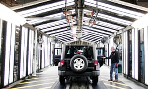 A Jeep Wrangler undergoes quality inspection at the Chrysler plant in Toledo, Ohio.