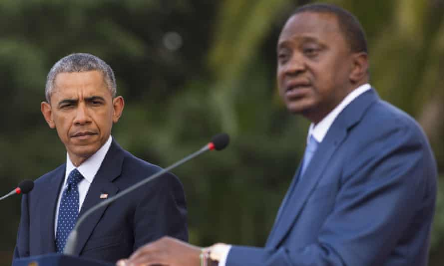 Barack Obama listens to his Kenyan counterpart, Uhuru Kenyatta, during a joint press conference.