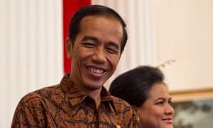 Indonesia's President Joko Widodo accompanied by First Lady Iriana Widodo