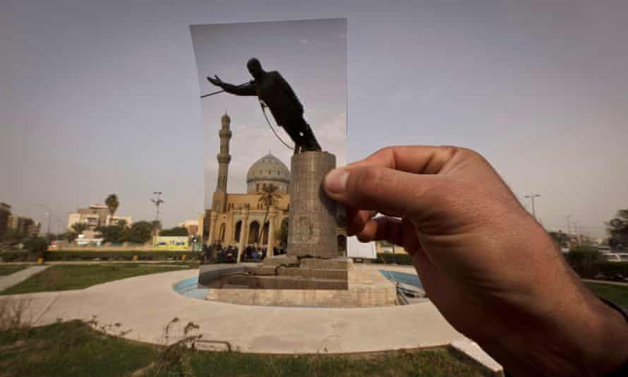 A general view of Firdous Square at the site of an AP photograph taken by Jerome Delay as the statue of Saddam Hussein is pulled down by US forces and Iraqis on 9 April 2003.