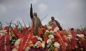 Statues of the late leaders Kim Il-sung, left, and Kim Jong-il tower over flower offerings at Munsu Hill on 27 July in Pyongyang, North Korea.