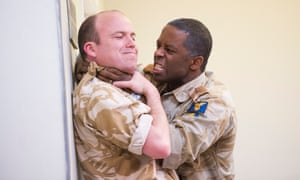Battling to survive ... Rory Kinnear and Adrian Lester in Othello at the National Theatre.
