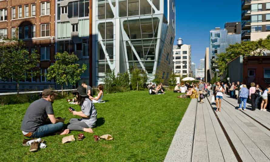 People having a picnic on the grass at the High Line Park in New York City
