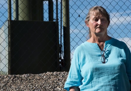 Shirley (Sug) McNall stands in front of a production gas well in Aztec New Mexico.
