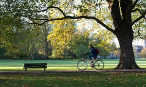 A man cycling along a path