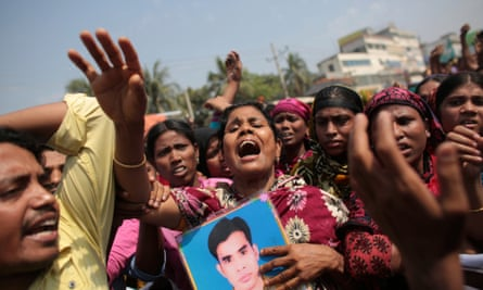 Relatives of victims killed in the collapse of Rana Plaza mourn on the first year anniversary of the accident