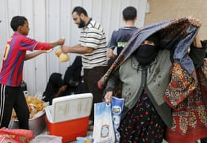 An elderly woman leaves a charity food assistance centre after receiving her ration in Yemen's capital, Sana'a.