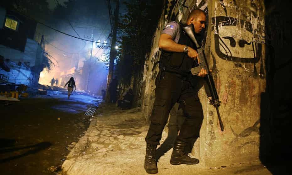 Brazilian police patrolling a street at night in Rio de Janeiro, Brazil.