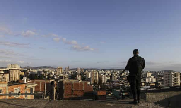 A soldier is pictured during a police operation to regain control of the Favela do Lins.