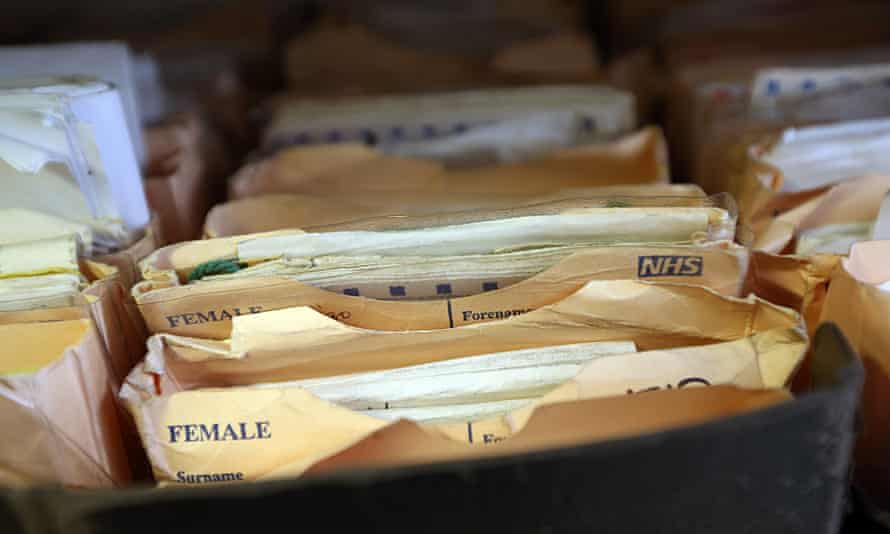Folders containing patient records in a GP surgery