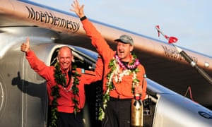 Solar Impulse 2 pilot Bertrand Piccard (left) and pilot André Borschberg celebrate after Borschberg safely landed at Kalaeloa airport, Hawaii.