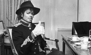 Michael Jackson and his signature gloved hand.