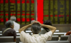 A Chinese investor monitors displays of stock information at a brokerage house in Beijing on Tuesday 28 July 2015.