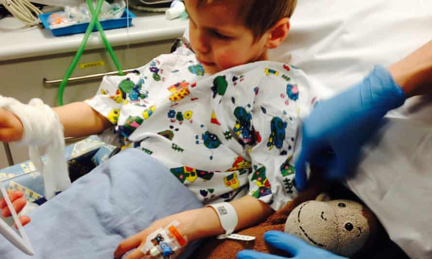 A child being prepared for surgery using an iPad