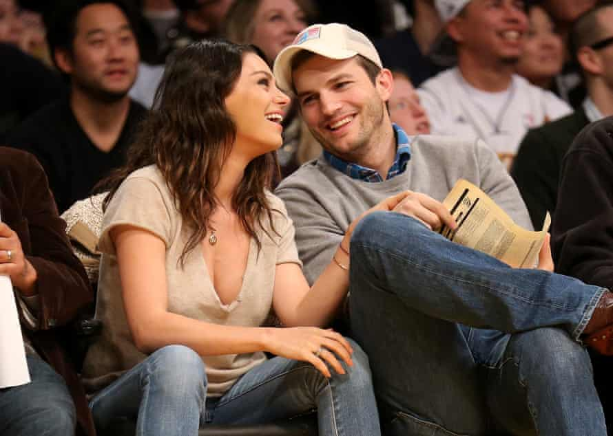 Mila Kunis, left, and Ashton Kutcher at a basketball game in Los Angeles last December.