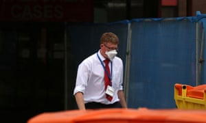 A man walks out of Manchester Royal infirmary A&E with a face mask on as the unit is closed amid Mers fears.
