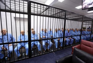 Former aides of deposed Libyan dictator Muammar Gaddafi behind bars. A Libyan court sentenced a son and eight aides of Gaddafi to death for crimes during the 2011 uprising after a trial overshadowed by the country's bloody division