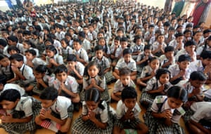 <strong>Bhopal, India</strong> Indian school children gather for a prayer for late Indian former President APJ Abdul Kalam, as they pay their respect at a school. Kalam, 83, collapsed while giving a lecture at a management institute in the Meghalaya state capital and was rushed to hospital were the doctors failed to resuscitate him, media reported