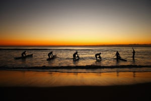 Ocean paddlers train on surf skis at Manly beach