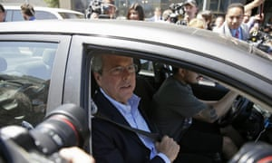 Republican presidential candidate Jeb Bush, puts on his seat belt gets into an Uber car after speaking at Thumbtack, an online startup in San Francisco.