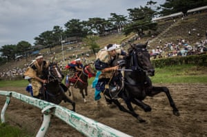 Samurai horsemen compete in the Kacchu-keiba (armed horse race) during the Soma Nomaoi festival at Hibarigahara field. The festival started as a military exercise more than 1000 years ago by Taira no Kojiro Masakado, the founder of the Soma Clan. The three-day Shinto festival sees more than 500 horsemen recreate ancient battle scenes from the Edo period