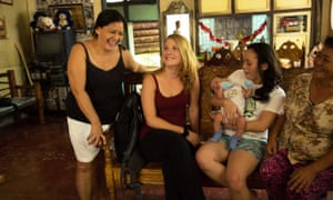 Family sitting in living room with volunteer