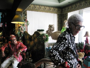 Carl Apfel, left, and Iris Apfel, right, at their home. Kermit and the ostrich are just seen in the background.