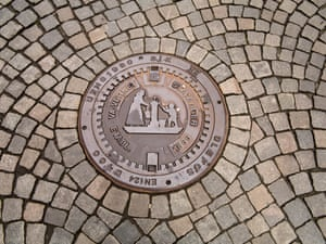 <strong>Stavanger, Norway<br></strong>A decorative sewer lid on a cobbled street