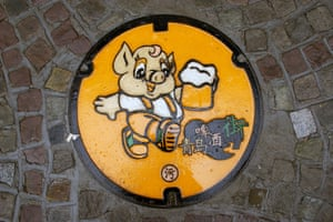 <strong>Qingdao, China<br></strong>A manhole cover near the Tsingtao beer brewery