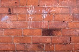 Hand Prints on brick wall