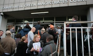 People issued with summons for council tax arrears by Southwark council wait outside Camberwell Magistrates court in October 2013.