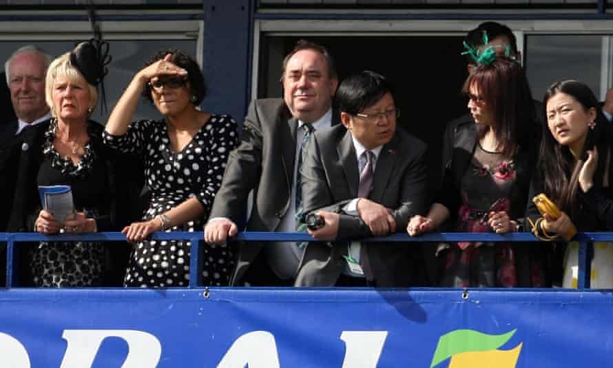 An eye for a winner: Alex Salmond (centre) watches racing at Ayr.