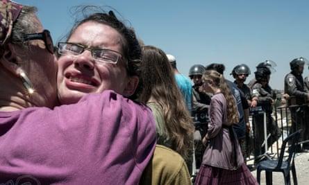 A Beit El settler breaks down in tears during the demolition of two buildings.
