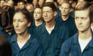 John Hurt (centre) as Winston Smith in the 1984 film version of Nineteen Eighty-Four directed by Michael Radford.