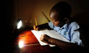 Boy doing homework with use of solar light