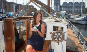 Smillie enjoys a cup of tea on her boat in South dock marina, Deptford.