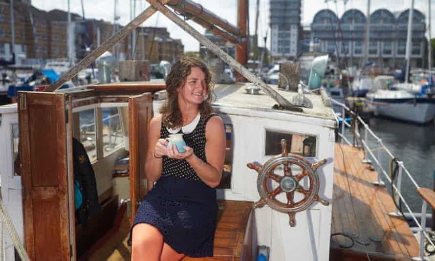 Smillie enjoys a cup of tea on her boat in South dock marina, Deptford.