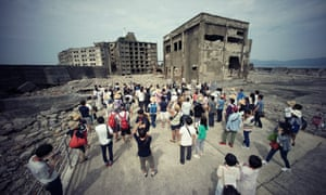 Tourists visit a part of Hashima Island, commonly known as Gunkanjima, which means battleship island, off Nagasaki prefecture, southern Japan.