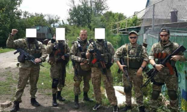 Fighters from the Sheikh Mansur battalion, some with their identity hidden, near the front line at Shirokyne on 30 June.