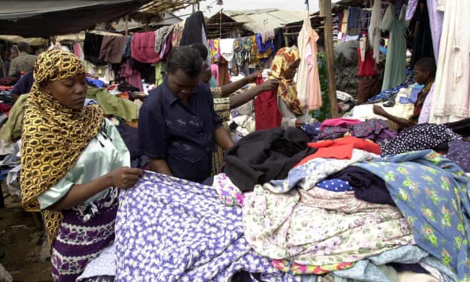 Kenyan women look for clothes at a second hand clothes market in Nairobi. (AP Photo/Khallil Senosi)