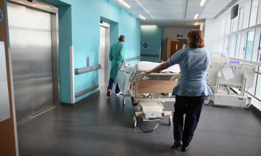 A patient is taken to the operating theatre in a hospital.
