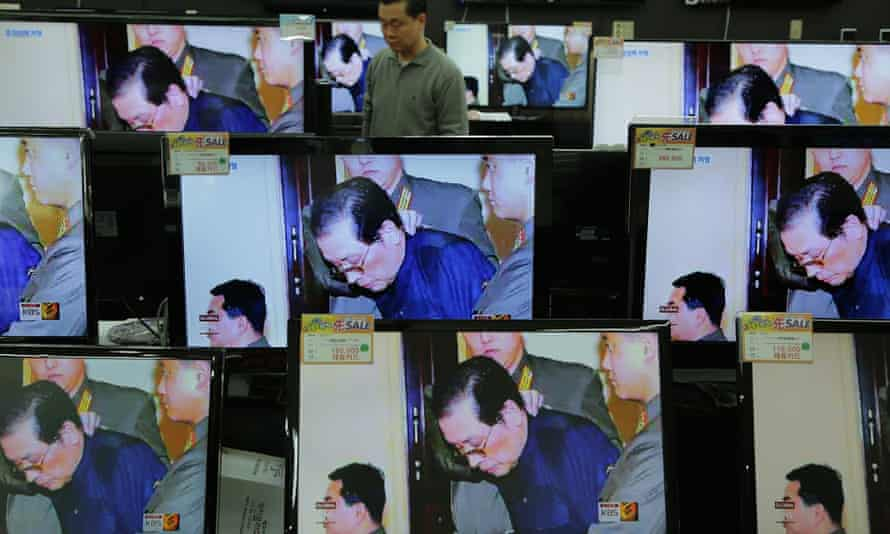 TV monitors displayed at Yongsan electronic market in South Korea report on the execution of Jang Song-Thaek, government official and Kim Jong-un's uncle, for treason.