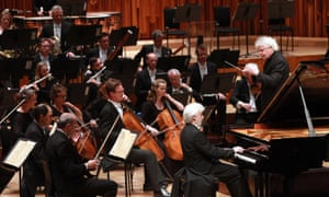 Sir Simon Rattle conducts the LSO with Krystian Zimerman at the Barbican, London.