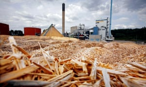 Fir and pine chips are piled high outside the electricity-and-heating plant in Vaxjo