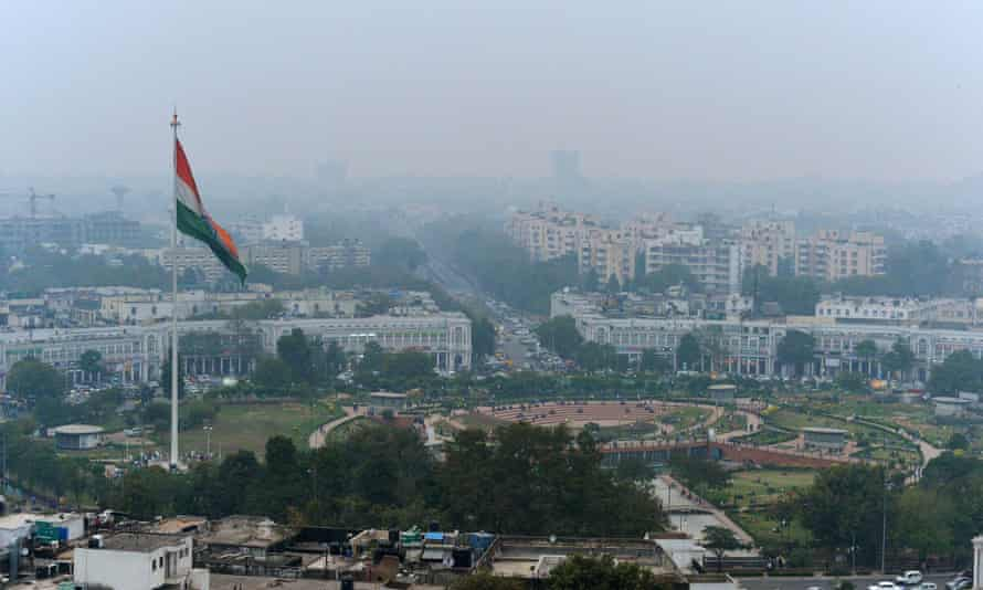 Indian tri-colour as it flies over Connaught Place in New Delhi, ahead of World Environment Day