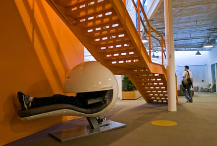 An employee snoozes in the nap pod at Google HQ. Apple, Nike and the Huffington Post have also introduced napping infrastructure into their offices.