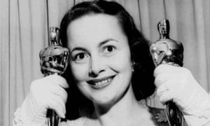 Olivia de Havilland, pictured in 1950 with her Oscars, changed the way celebrity was manufactured.