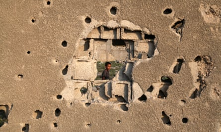 Bullet and shell holes on a house in Gaza. Three-quarters of Gaza's children experience unusual bedwetting regularly, and nine in 10 report constant feelings of fear, says a Save the Children report.