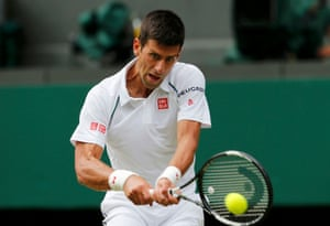 Novak Djokovic powers a return as he takes control of the first set against Tomic.